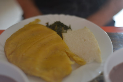 The national dish of Uganda. Matoke and Posho. It may resemble plasticine  and chalk but it does taste a little better. Matoke is mashed cooking banana (not plantain) and posho is maize flour and water cooked to a dense block