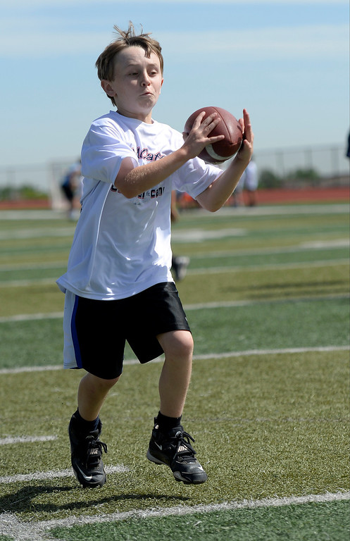 """. Logan Cass 10, of Parker catches a pass during The Ed McCaffrey \""""Open\"""" Football Camp June 25, 2013 at Valor High School. Former Broncos star receiver Ed McCaffrey and other former pro football players conduct a football camp for kids ages 8-15 at Valor Christian High School. (Photo By John Leyba/The Denver Post)"""