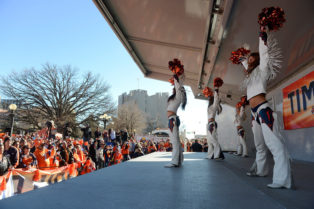 . DENVER, CO. - JANUARY 17:  the Denver Broncos cheerleaders take the stage during a rally at Civic Center Park Friday afternoon, January 17, 2014. (Photo By Andy Cross / The Denver Post)