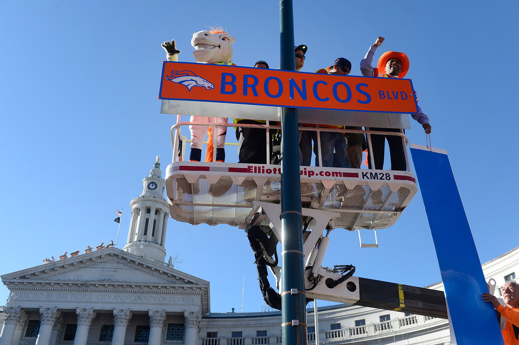 . DENVER, CO. - JANUARY 17:  Denver Mayor, Michael Hancock, right, and Denver Broncos mascot, �Miles� left, unveil �Broncos Blvd,� along Bannock St. in front of the Civic Center Building during a Denver Broncos rally at Civic Center Park Friday afternoon, January 17, 2014. (Photo By Andy Cross / The Denver Post)