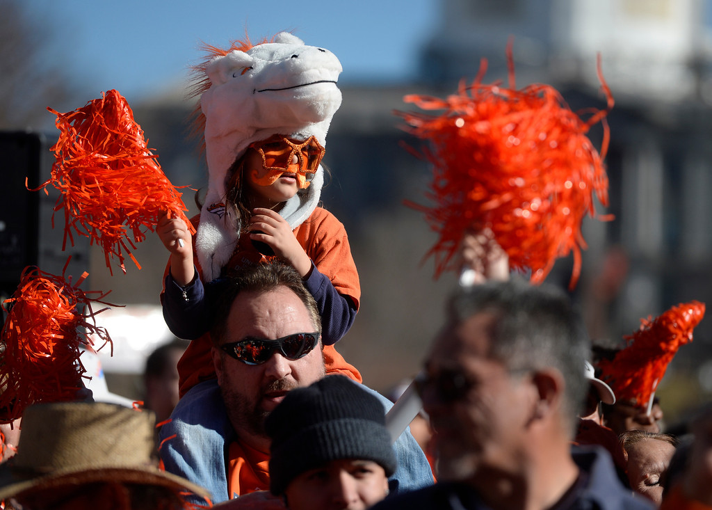 . DENVER, CO. - JANUARY 17:   A young Denver Broncos fan gets a lift on shoulders to get a better view of the Broncos rally at Civic Center Park Friday afternoon, January 17, 2014. (Photo By Andy Cross / The Denver Post)