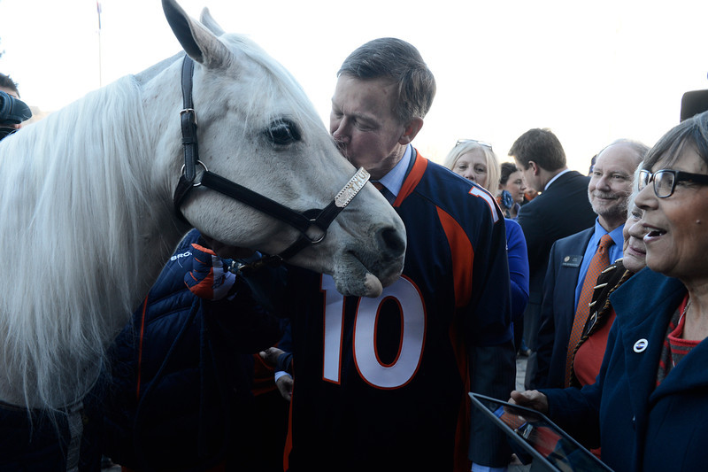 . Colorado Governor, John Hickenlooper, kisses Denver Broncos mascot, �Thunder� on the west steps of the Colorado Capitol Friday morning, January 17, 2014 in celebration of Sunday\'s AFC Championship game against the New England Patriots. (Photo By Andy Cross / The Denver Post)