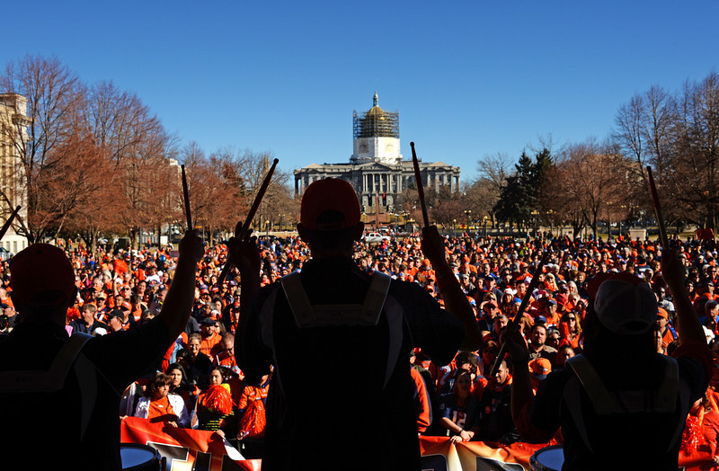 . The Denver Broncos Stampede Drumline fires up the crowd during a pep rally for the Denver Broncos outside the City and County Building, January, 17 2014. Fans who attend got a chance to enter to win tickets to the game. (Photo by RJ Sangosti/The Denver Post)