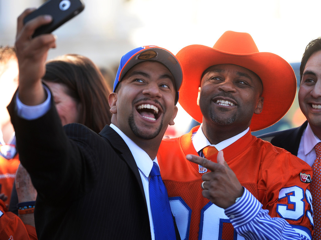 . DENVER, CO. - JANUARY 17:   Denver City Council member, Paul Lopez, left, snaps a picture of himself with Denver Mayor, Michael Hancock, during a Denver Broncos rally at Civic Center Park Friday afternoon, January 17, 2014. (Photo By Andy Cross / The Denver Post)