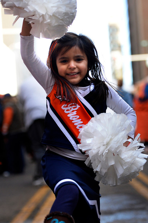 . 4 year old Jaselle Dass-Gonzales shows her spirit as fans gathered to show their support for the Denver Broncos at Denver Pavilions on the 16th Street Mall for their playoff run on as the team prepares to host the San Diego Chargers in an AFC Divisional Playoff Game. (Photo By Joe Amon/The Denver Post)
