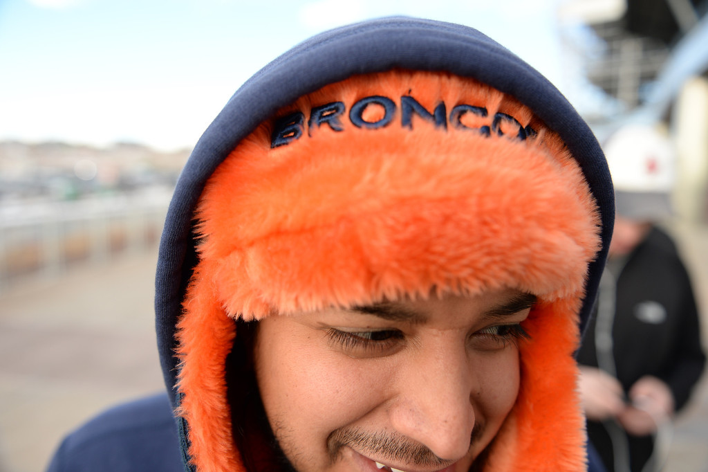 . Broncos fan Efren Parra waits in line to buy tickets for the up coming game at Sports Authority Field at Mile High, January, 10 2014. The Denver Broncos will take on the San Diego Chargers in the second round of the NFL playoffs in Denver. (Photo by RJ Sangosti/The Denver Post)