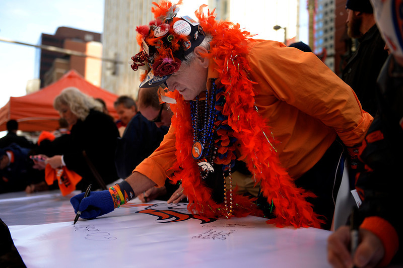 . 67 year old Billy Hart sends encouragement to the Broncos as fans gathered to show their support for the Denver Broncos at Denver Pavilions on the 16th Street Mall for their playoff run on as the team prepares to host the San Diego Chargers in an AFC Divisional Playoff Game. (Photo By Joe Amon/The Denver Post)