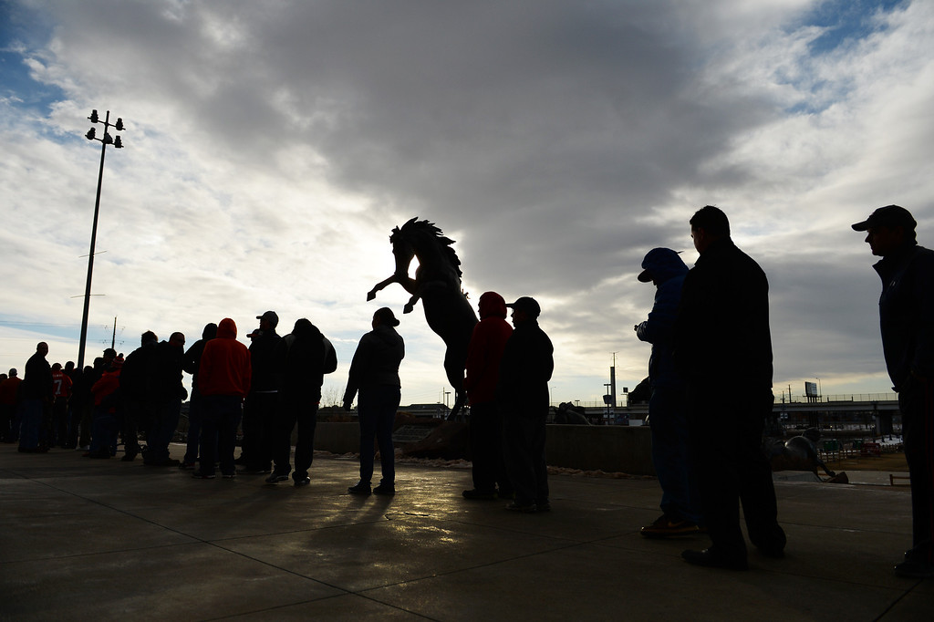 . Broncos fans lines up outside Sports Authority Field at Mile High to buy tickets for the upcoming game, January, 10 2014. The Denver Broncos will take on the San Diego Chargers in the second round of the NFL playoffs in Denver. (Photo by RJ Sangosti/The Denver Post)