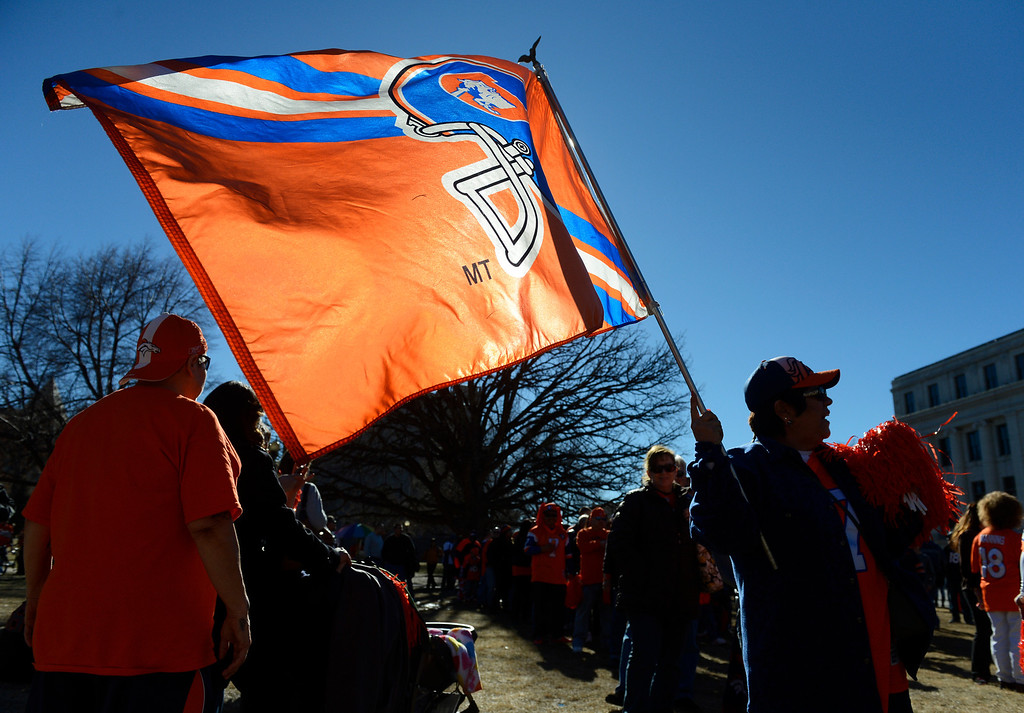 . DENVER, CO. - JANUARY 17:   A Denver Broncos fan flies the Broncos flag at a Denver Broncos rally at Civic Center Park Friday afternoon, January 17, 2014. (Photo By Andy Cross / The Denver Post)