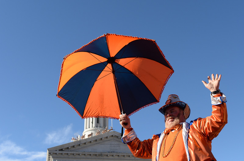 """. Rocky, \""""The Colorado Leprechaun,\"""" cheers during a pep rally for the Denver Broncos outside the City and County Building, January, 17 2014. Fans who attend got a chance to enter to win tickets to the game. (Photo by RJ Sangosti/The Denver Post)"""