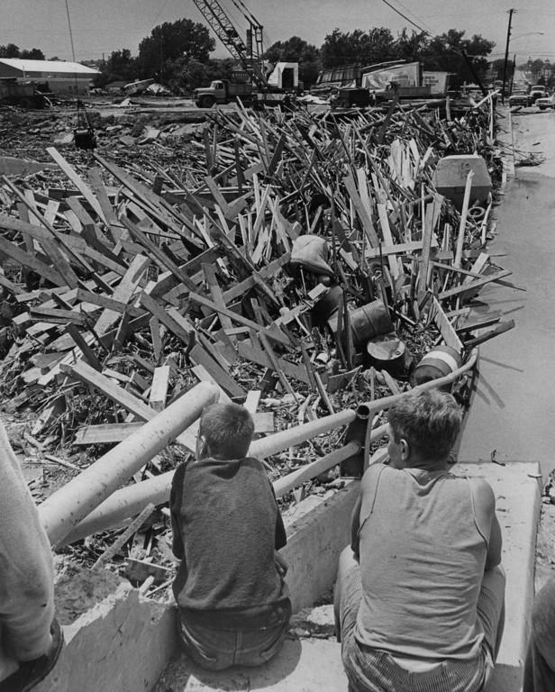 . JUN 16 1965  Mark Phillips 14 2201 Lowell Blvd. and Mike Marshall, 13 of Huntsville Alabama have good view of ***** at Evans St Bridge.  (David Mathias/ The Denver Post)