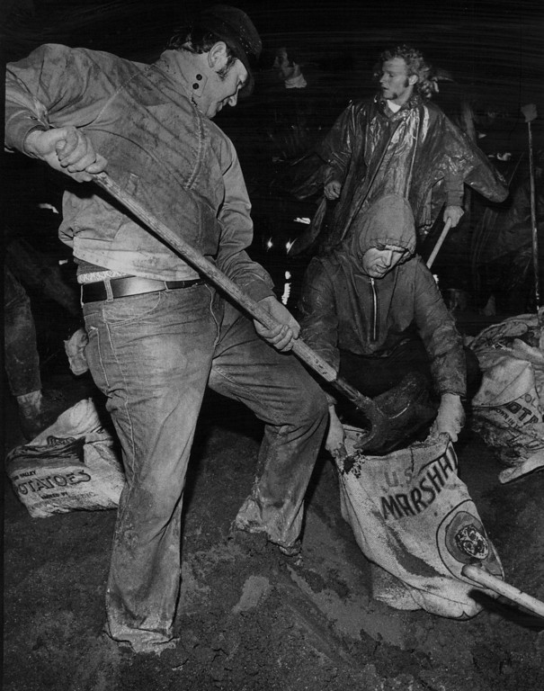 . MAY 6 1973  Volunteers Prepare Sanbags To Block flow of Highline Canal. More than 30 truckloads of sand were used trying to dam the canals route to the reservoir.  (Barry Staver/ The Denver Post)