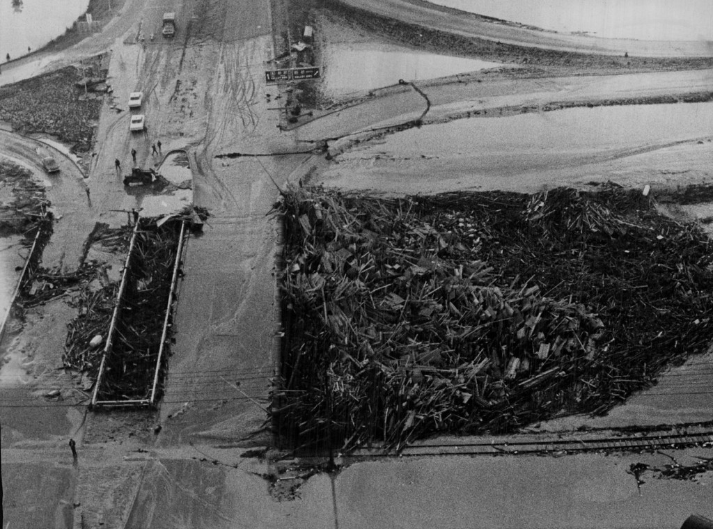 . 1965, JUN 15  This is a closeup of the W.6th Ave. twin bridges over the South Platte River. The scene looks east. The division of the bridges shows that debris is piled up under the bridge as well as on the south side.  (Ed Maker/ The Denver Post)