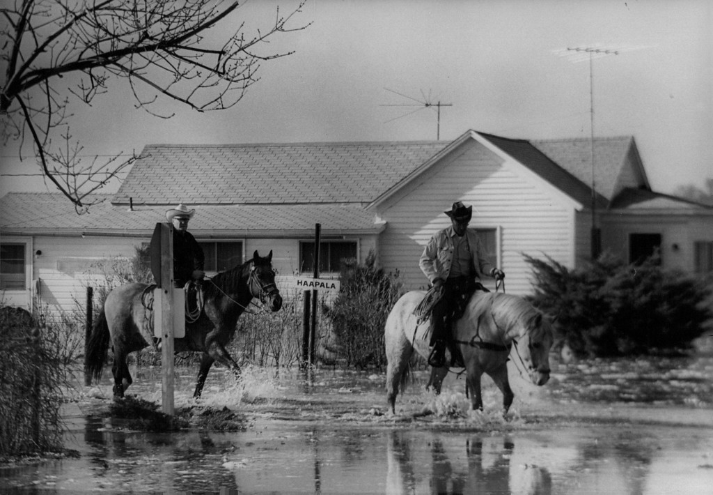 . APR 13 1973 - Horses provide 6 handy and reliable means of transportation as floodwaters limited motor-vehicle travel. Up to three or four feet of water covered the streets of the town of 900 persons seven miles east of Greeley. (Dave Buresh/ The Denver Post)