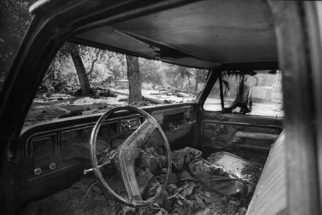 . AUG 3 1976  Mud and leaves dry out inside a wrecked truck along Big Thompson river Tuesday The truck was found in a campground following the disastrous flood in the canyon Saturday night and Sunday.  (David Cupp/ The Denver Post)