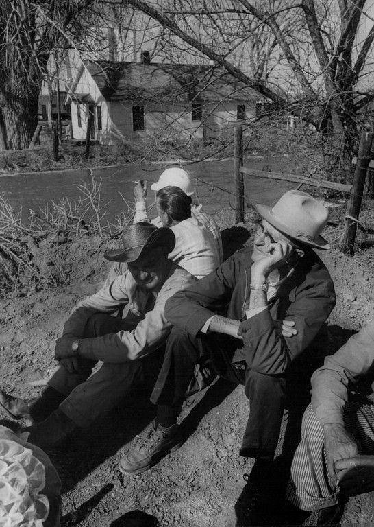. APR 13 1973  Bill Tetiva, 64,-right, and John Romans, 72, sit on high ground south of Kersey speculating on their homes while floodwaters swept through the town.  (Dave Buresh/ The Denver Post)