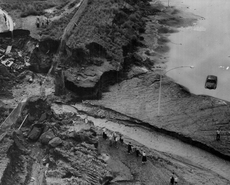 . 1956, JUL 31  From a low-swooping helicopter, this aerial photo shows the hundreds of tons of dirt washed down into the Valley Highway roadway at E. Florida Ave. (left) by surface flooding pouring off the streets in the vicinity of South high school in the wake of Monday and Tuesday nights\' heavy rains. Driver of the car was attempting to take exit ramp at S. Downing when the engine flooded. He got out safely. This washout is about midway between the S. Downing St. bridge and the S. Franklin span over the Valley Highway. This view looks east.  (Dean Conger/ The Denver Post)