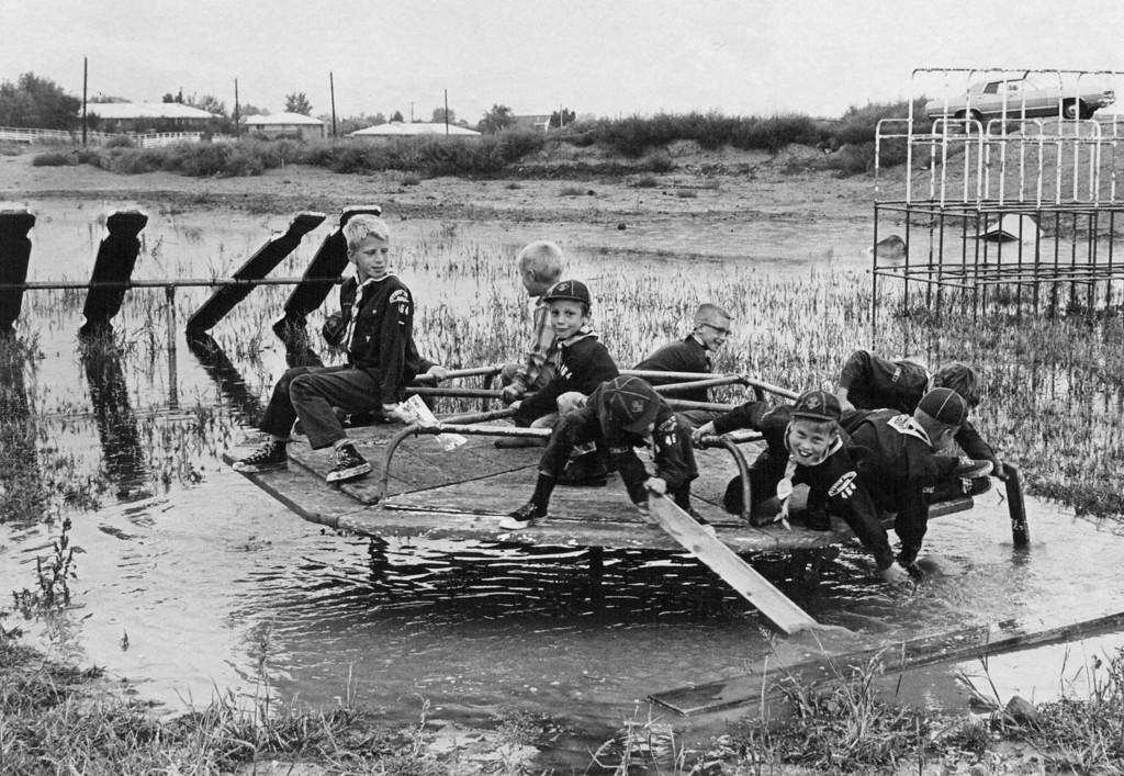 . SEP 17 1969 - After A Work Session, Cub Scouts Give The Merry-Go-Round A Whirl. The flooded playground will be one of the targets in Littleton\'s clean-up drive. (Floyd H. McCall / The Denver Post)