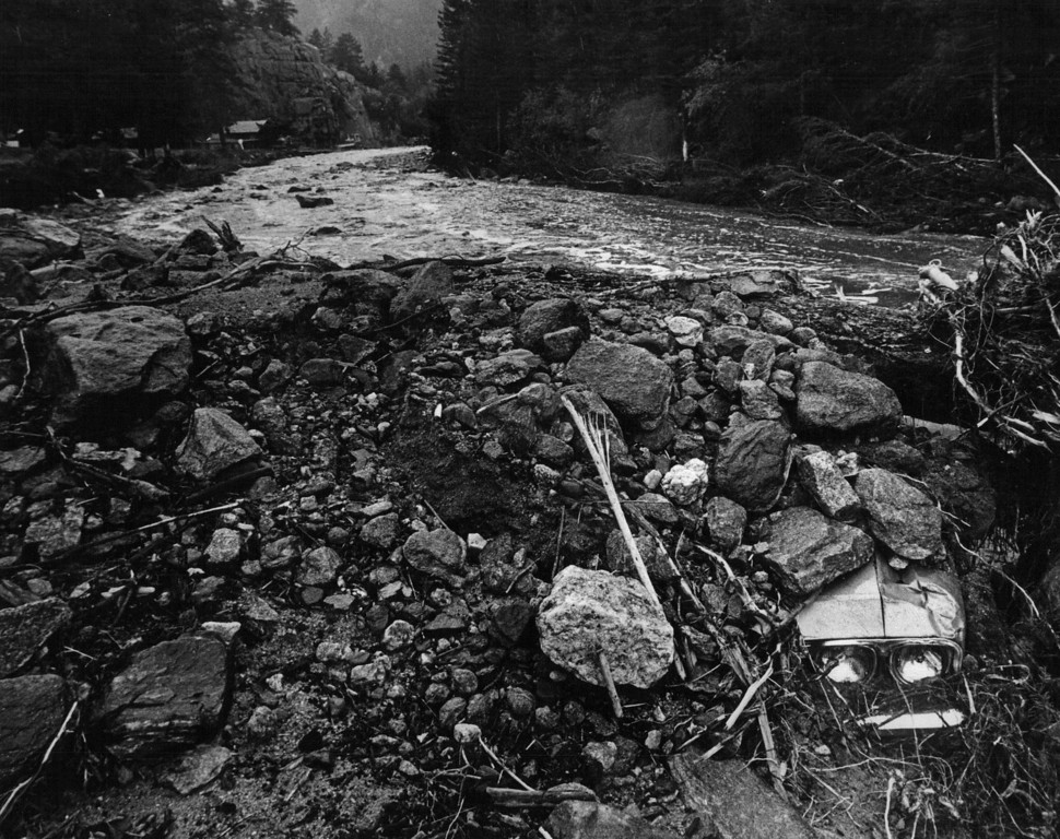 . AUG 1 1976  A Resident of Big Thompson Canyon surveys damage to home in trailer park about five miles from Loveland.  (Ernie Leyba/ The Denver Post)