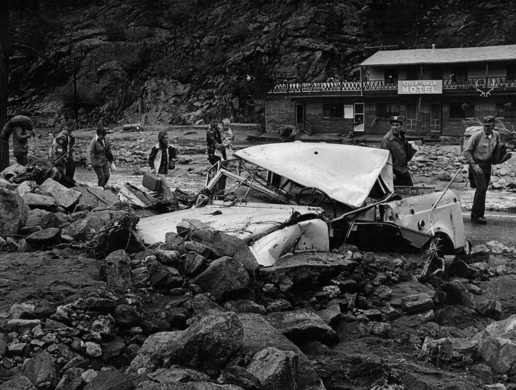 . AUG 1 1976  Water-battered motels and refugees were a common sight.  (Ernie Leyba/ The Denver Post)Inc
