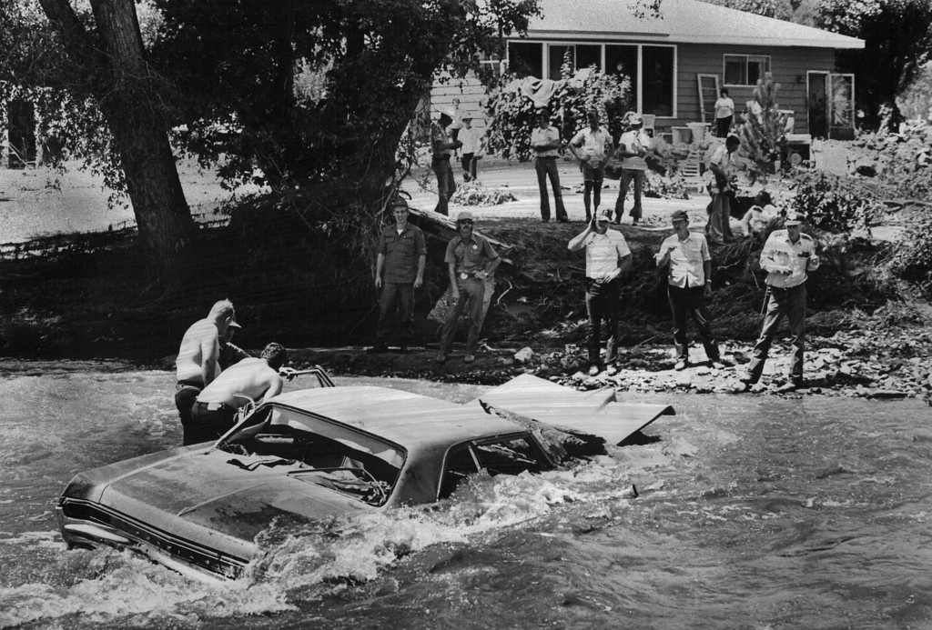 . AUG 5 1976  Searchers Look Through A Car In Big Thompson River Three Miles West Of Loveland To Make Sure It Has No Bodies In It. They found none here Wednesday, but many have been found in similar situations and many still are to be brought out of the Big Thompson Canyon.  (Dave Buresh/ The Denver Post)