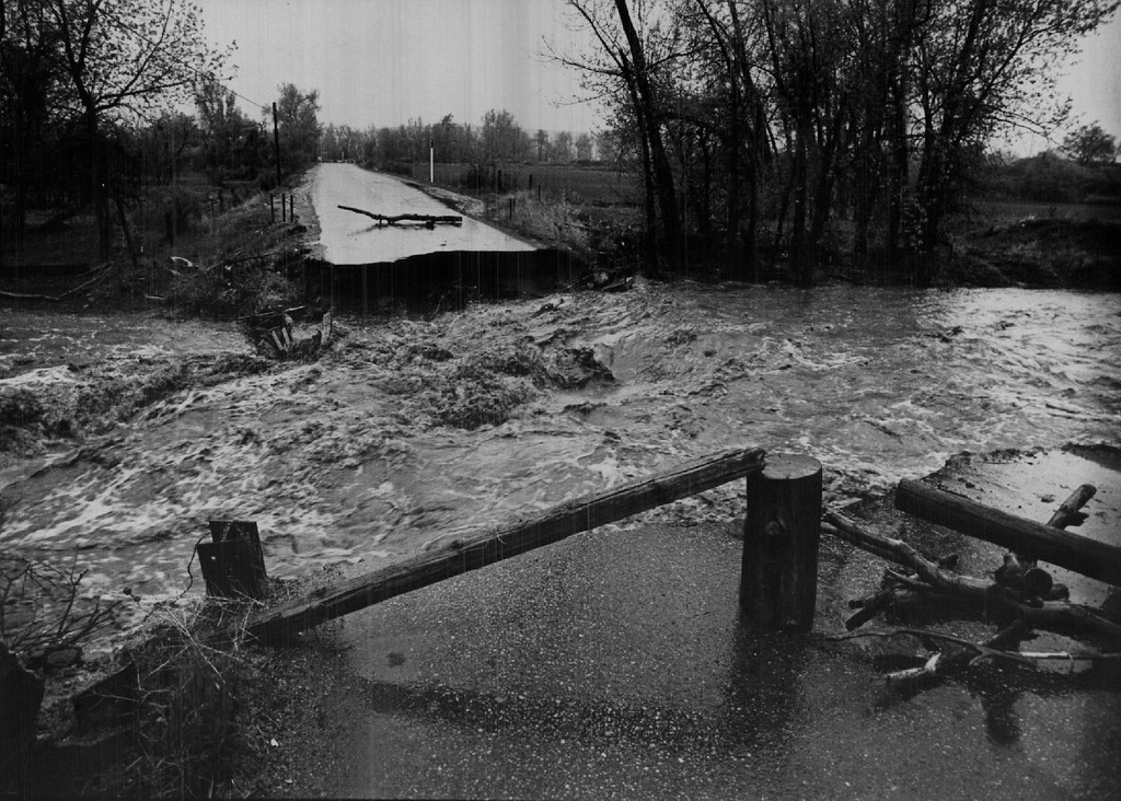 . MAY 6 1969  So Bang St & Bear creek (near Morrison) Raging bear creek flows through ripped- out section of S. Zang St. View south shows broken bridge supports and caved-in section of the road about three miles east of Morrison.  (Bill Wunsch/ The Denver Post)