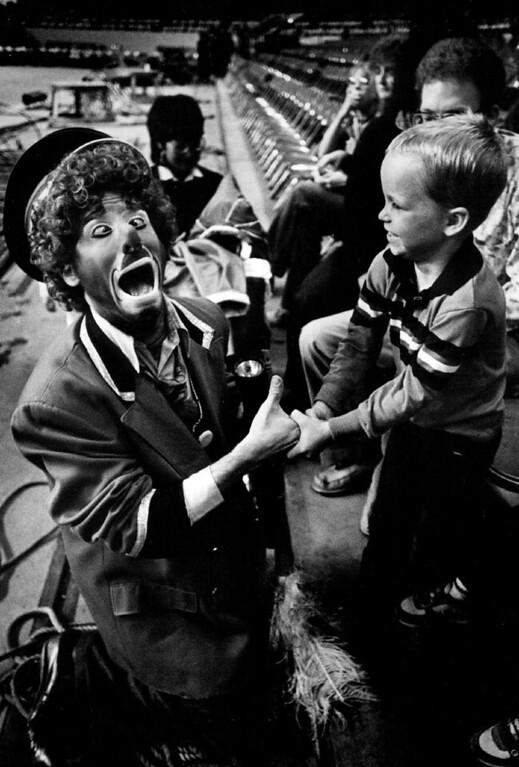 . OCT 5 1984 - Scott Linger (clown) handshake, Dean Krohn, 7 from Lakewood circus for the deaf/ Bling  Dean who is deaf shakes the hands clown (linger) before the show. (Lyn Alweis/The Denver Post)