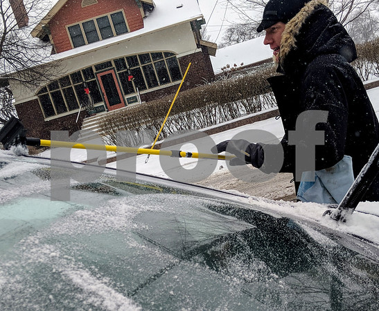Josh Arends of Chicago cleaned the snow and ice from his car Friday in Sycamore after a visit with his parents. In Sycamore's residential areas, there is no requirement to remove snow from your property, but it is encouraged.