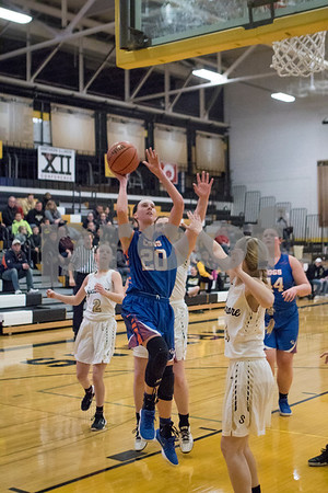 Sam Buckner for Shaw Media.<br /> Taylor Gilbert goes up for a layup on Tuesday January 2, 2018 at Sycamore High School.