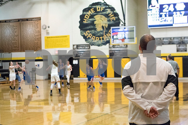 Sam Buckner for Shaw Media.<br /> Adam Wickness watches his team run a play against Genoa-Kingston on Tuesday January 2, 2018.