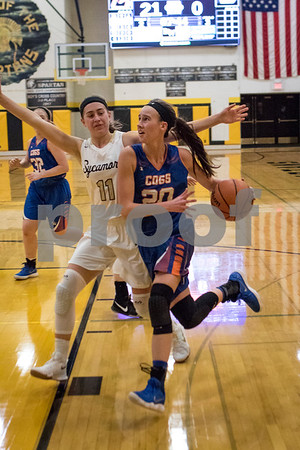 Sam Buckner for Shaw Media.<br /> Taylor Gilbert drives to the basket while being guarded by Kate Majerus on Tuesday January 2, 2018.