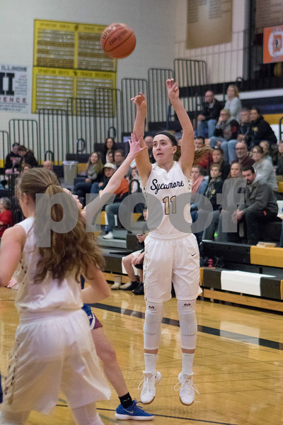 Sam Buckner for Shaw Media.<br /> Kate Majerus shoots and makes a three pointer early in the game against Genoa-Kingston on Tuesday January 2, 2018.