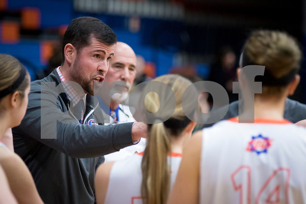 Sam Buckner for Shaw Media.<br /> Genoa-Kingston head coach Kyle Henkel talks to he team during a timeout in the first half against Sycamore on Tuesday January 2017.