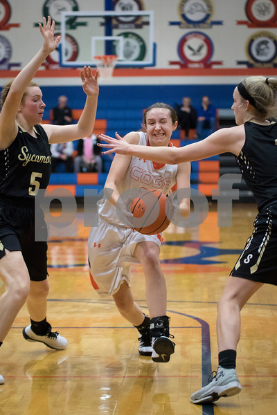 Sam Buckner for Shaw Media.<br /> Amanda Anderson drives through Sycamore defenders on Tuesday January 3, 2017.
