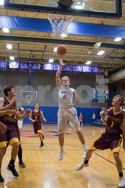 Sam Buckner for Shaw Media.<br /> Justin Peters puts up a shot under the basket on Wednesday January 3, 2018.