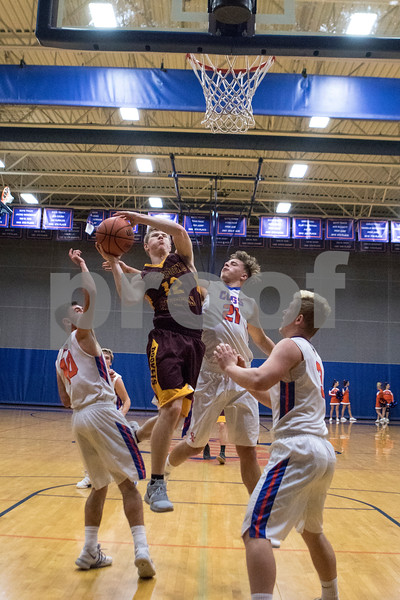 Sam Buckner for Shaw Media.<br /> Jefferey Jankowski Jr. puts up a layup on Wednesday January 3, 2018 at Genoa-Kingston High School.