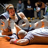 Sam Buckner for Shaw Media.<br /> Austin Johnson tries to pin Keith Clausen of Kaneland in the 138lb match on Thursday January 5, 2017.