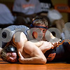 Sam Buckner for Shaw Media.<br /> Trevor Jones checks the clock while wrestling Jacobe Schmerbach in the 160lb match on Thursday January 5, 2017.