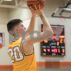 Sam Buckner for Shaw Media.<br /> Sean Gingrich takes a jumpshot on Friday January 5, 2018 at DeKalb High School.