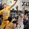 Sam Buckner for Shaw Media.<br /> Aidan Shore snags a rebound on Friday January 5, 2018.