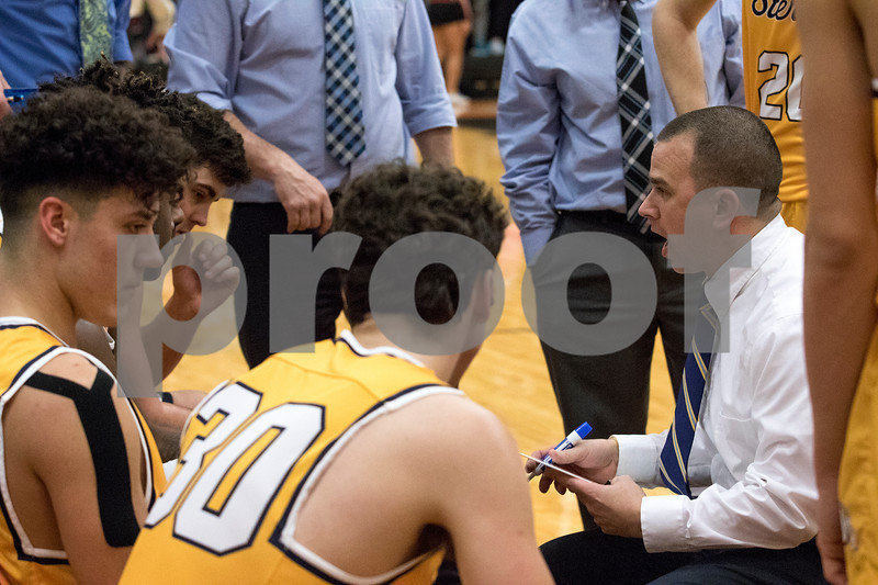 Sam Buckner for Shaw Media.<br /> Head coach Ryan Vasquez talks to his team during a time out in the third quarter against DeKalb on Friday January 5, 2018.
