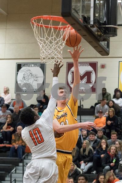 Sam Buckner for Shaw Media.<br /> Aidan Shore puts up a shot on Friday January 5, 2018 at DeKalb High School.