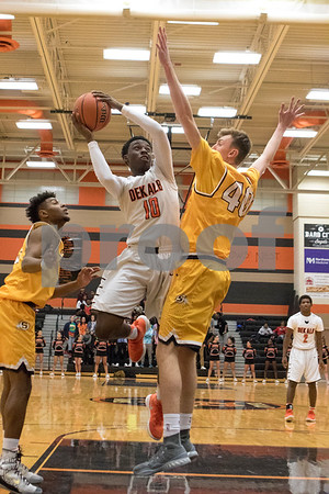 Sam Buckner for Shaw Media.<br /> Michael Newman goes up with the ball while being guarded by Sterling's Aidan Shore on Friday January 5, 2018.