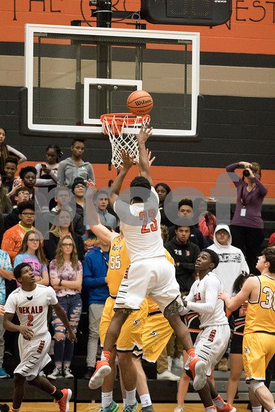 Sam Buckner for Shaw Media.<br /> Marcus Bobo takes a jump shot on Friday January 5, 2018 against Sterling High School.