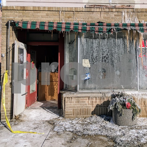 The door was still open at the burned out Cutters Family Hair Care salon in Genoa on Friday, three days after the building was engulfed in flames. Owner Jennifer Kohler has said she plans to reopen the store.