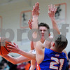 Sandwich's Carter Cech runs into Genoa-Kingston's Michael Trzynka (21) during a boys varsity basketball game at Sandwich High School on Friday, January 5, 2018. Steven Buyansky - For Shaw Media