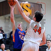 Genoa-Kingston's Will Franson (12) has his shot blocked by Sandwich's Luke Bell (44) during a boys varsity basketball game at Sandwich High School on Friday, January 5, 2018. Steven Buyansky - For Shaw Media