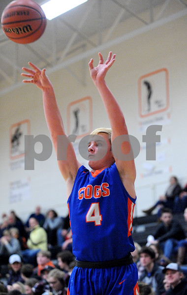Genoa-Kingston's Justin Peter's lets go of a three-point shot during a boys varsity basketball game at Sandwich High School on Friday, January 5, 2018. Steven Buyansky - For Shaw Media
