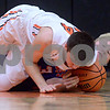 Sandwich's Luke Bell (44) and Genoa Kingston's Brett Marth (3) battle on the floor for a loose ball during a boys varsity basketball game at Sandwich High School on Friday, January 5, 2018. Steven Buyansky - For Shaw Media