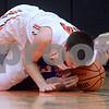 Sandwich's Luke Bell (44) and Genoa Kingston's Brett Marth (3) battle on the floor for a loose ball during a boys varsity basketball game at Sandwich High School on Friday, January 5, 2018. Steven Buyansky - For Shaw Media